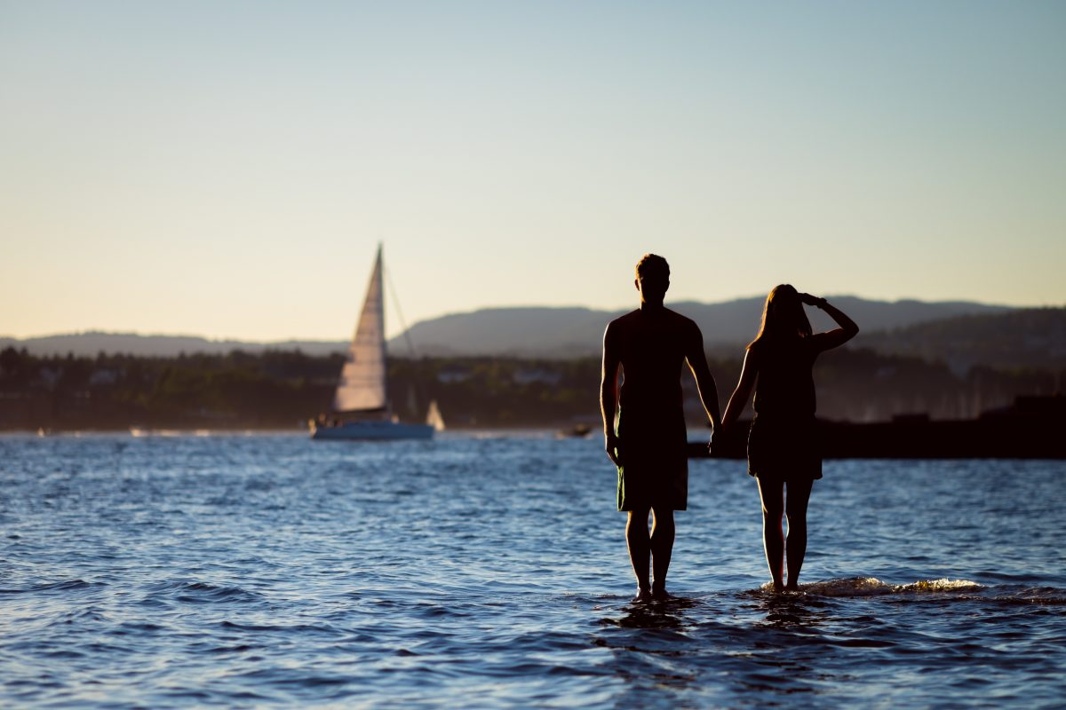 honeymoon, couple holding hands on beach