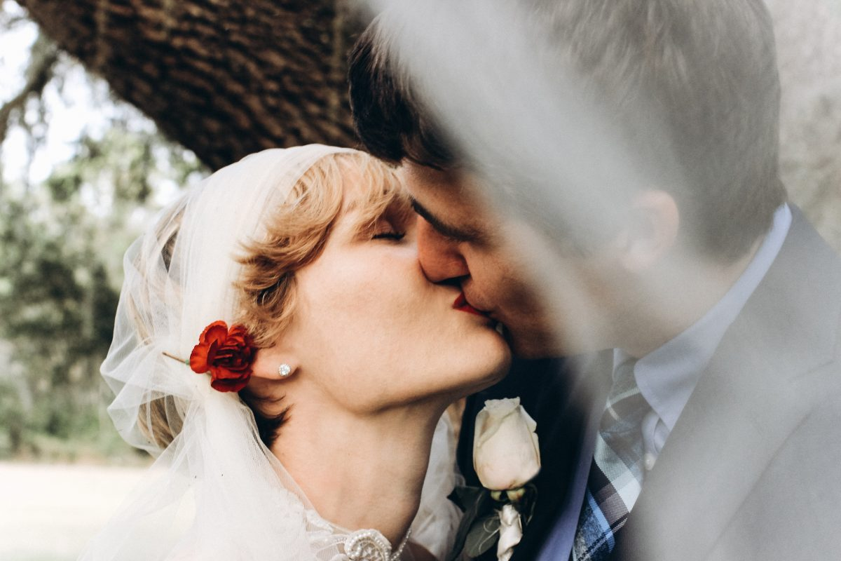 first kiss of a newly wed couple